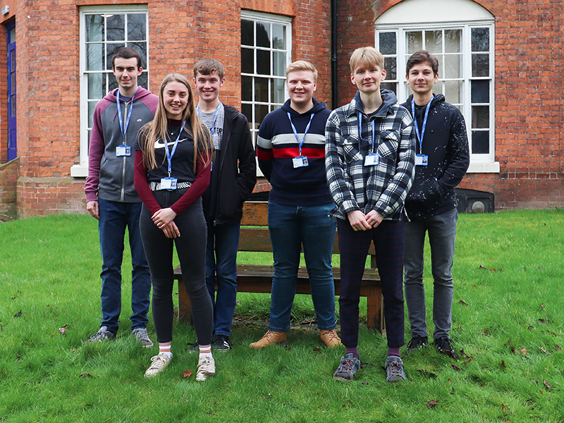 Seven Shrewsbury Colleges Group students standing in college grounds