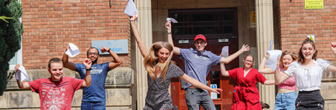 Students with exam results outside college building