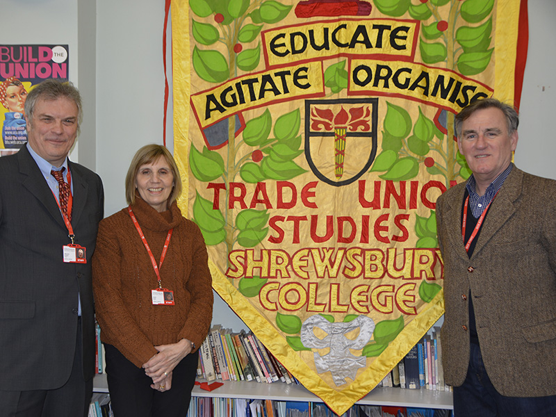 TUS teachers at Shrewsbury Colleges Group and the Head of Trade Union Studies standing in front of union banner