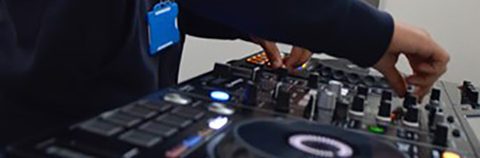 Hands using DJ mixing deck
