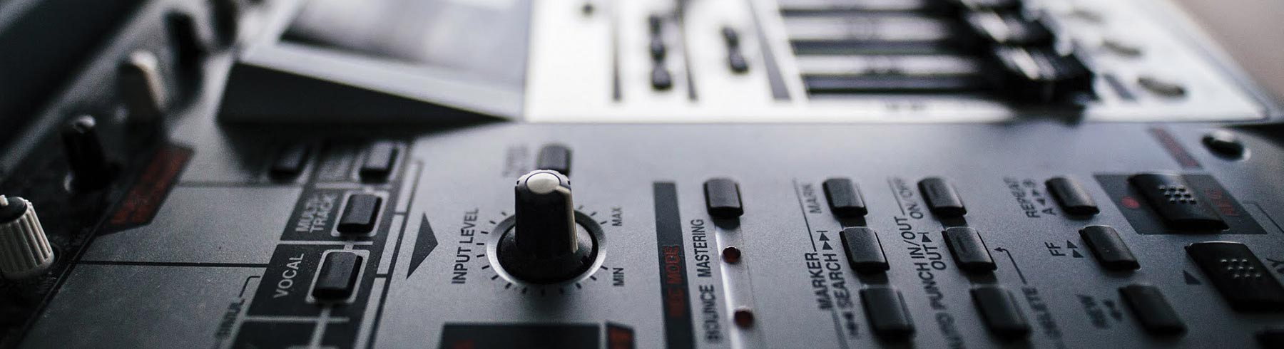 A closeup of the dials on a mixing deck