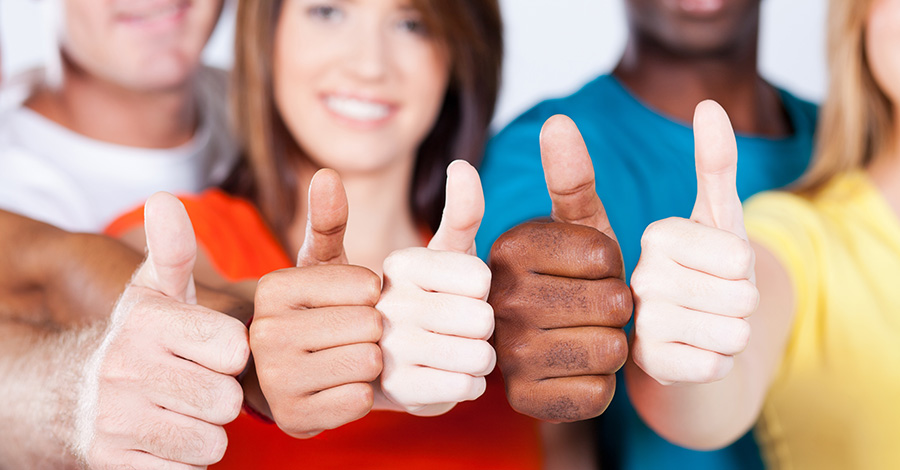 photo of young people with their thumbs up